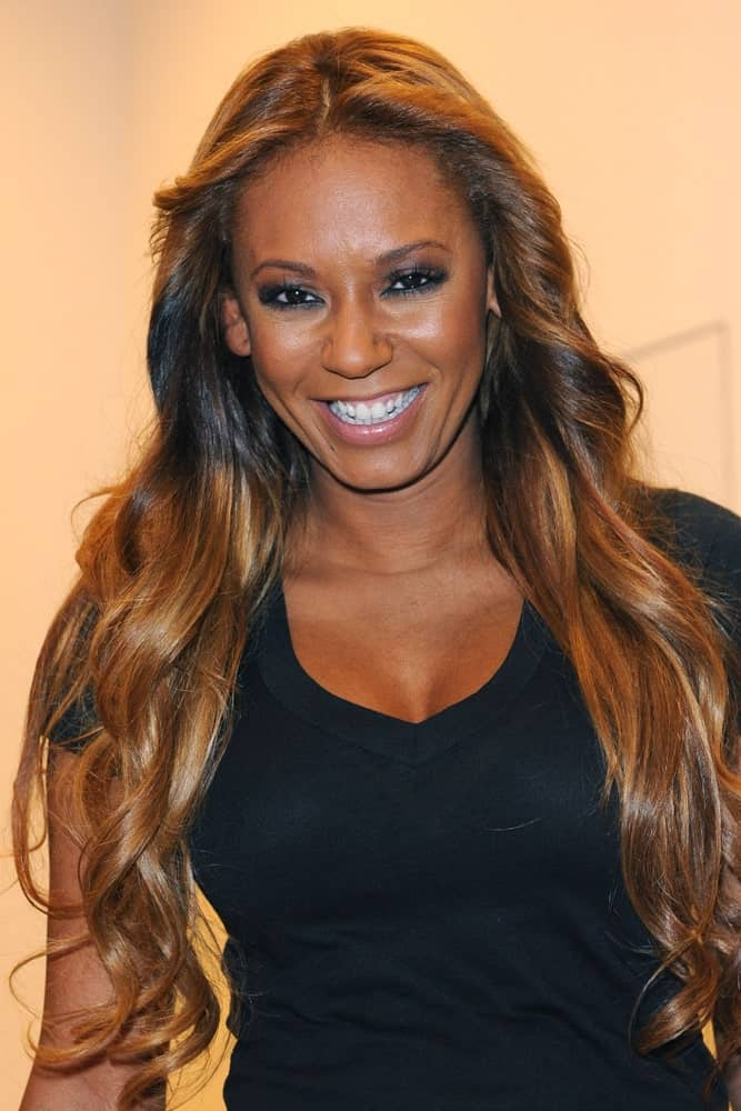 Mel B strikes a pose flaunting her ultra-long waves with a middle parting in Italy, Milan on January 25, 2018.