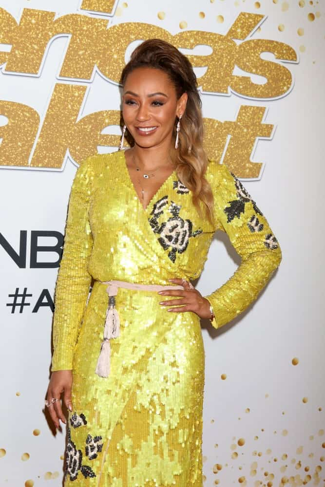 Mel B is ravishing in a yellow sequined dress along with her brown highlighted curls that she wore during the