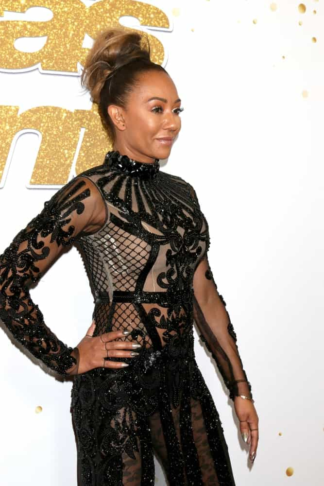 """Mel B pulled back her brown highlighted locks into a thick, high bun at the """"America's Got Talent"""" Live Show Red Carpet held on August 21, 2018."""