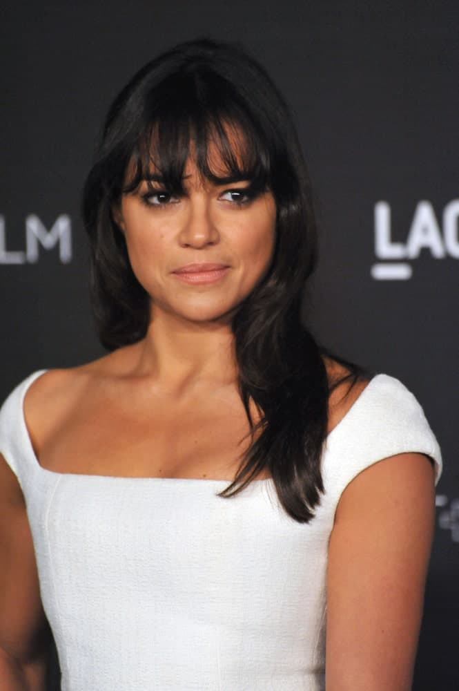 Michelle Rodrigues looks sophisticated in a white dress that's contrasted with her jet black waves and wispy bangs at the 2014 LACMA Art+Film Gala on November 1, 2014.