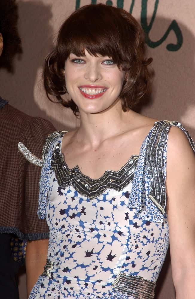 On Feb 12, 2005, Milla Jovovich was at the Clive Davis' Annual pre-Grammy party at the Beverly Hills Hotel. She was charming in a patterned dress that she paired with a tousled chin-length hairstyle with bangs.