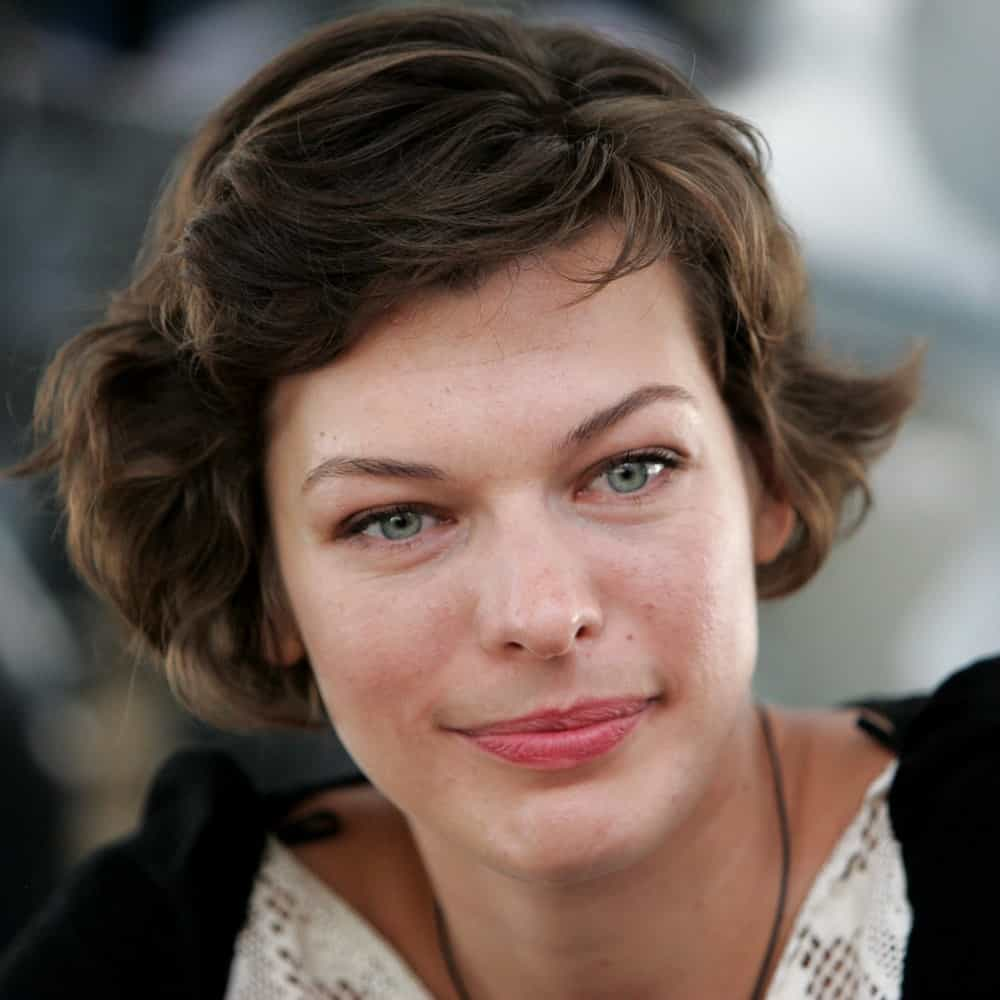 Actress Milla Jovovich was in an interview with journalists at a Moscow hotel on April 22, 2006. She was seen wearing a casual black and white dress to pair with her tousled pixie hairstyle with subtle highlights.