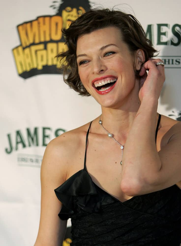 Actress Milla Jovovich attended the MTV Russia Movie Awards ceremony in Moscow on April 21, 2006. She was seen wearing a black dress with her tousled and side-swept raven pixie hairstyle.