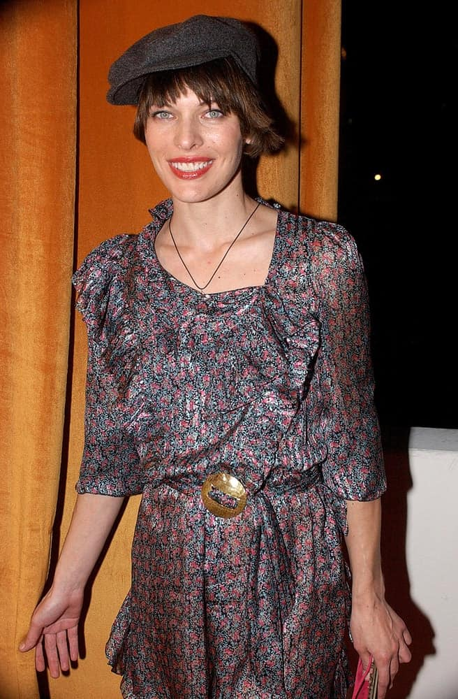 Milla Jovovich was at The Weinstein Company Golden Globe Party held at the Trader Vic's Restaurant at The Beverly Hilton Hotel, Los Angeles, CA on January 16, 2006. She was wearing a colorful dress to pair with her dark brunette pixie hairstyle incorporated with a hat.