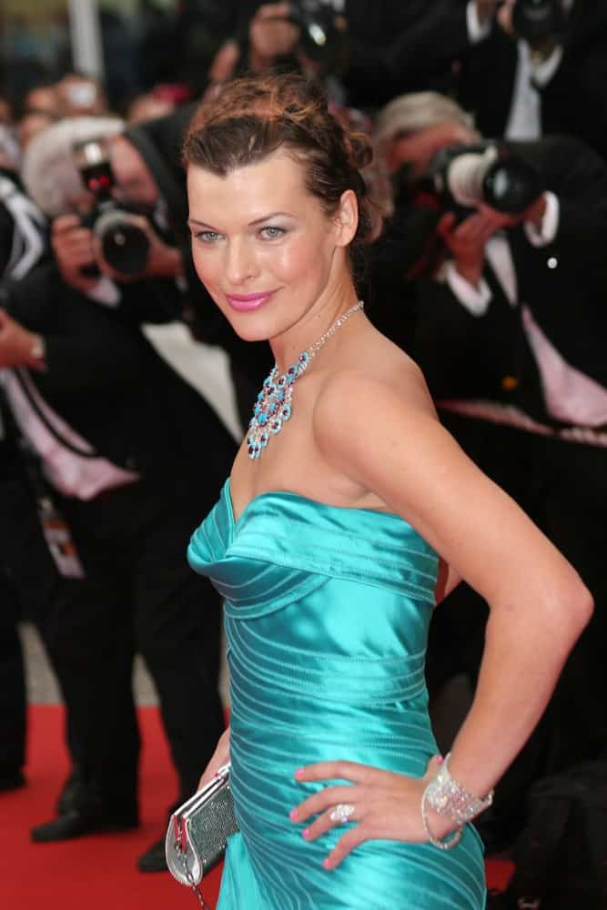Actress Milla Jovovich was at the Palme d'Or Closing Ceremony at the Palais des Festivals during the 61st Cannes Film Festival on May 25, 2008 in Cannes, France. She wore an elegant turquoise strapless dress with her upstyle brunette hairstyle with a slight tousle and braids.