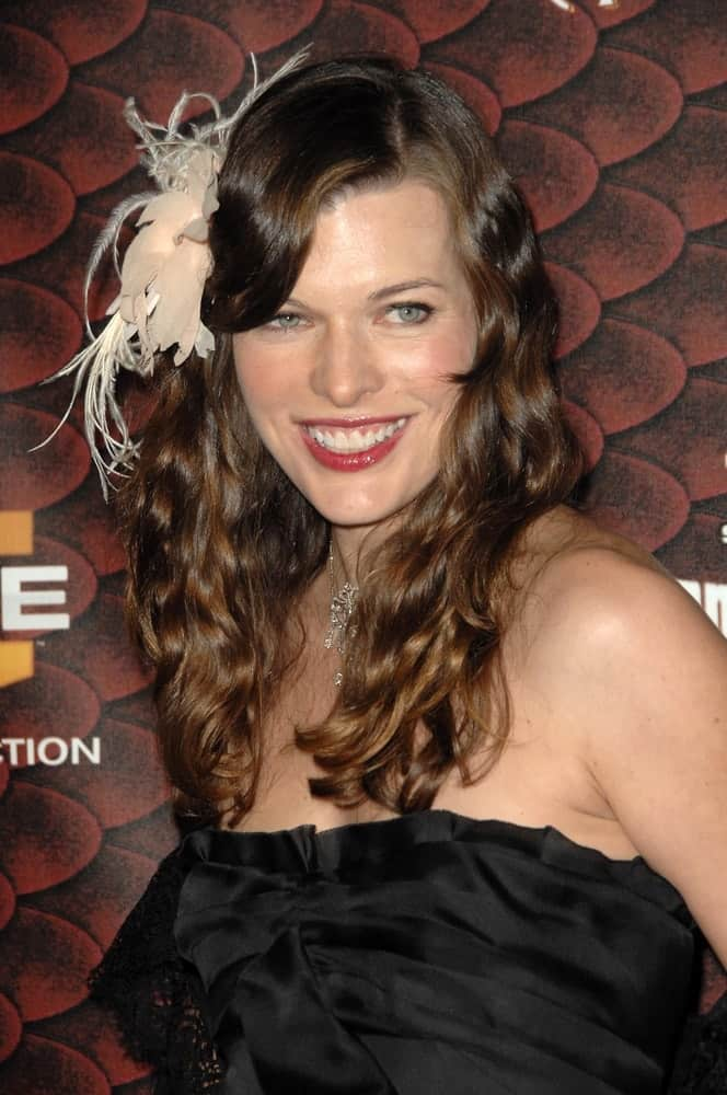 Milla Jovovich attended the Spike Tv's 'Scream 2008' held at the Greek Theatre in Hollywood, CA on October 18, 2008. She came wearing a black strapless dress with her long and curly brunette hairstyle incorporated with a ribon and side-swept bangs.