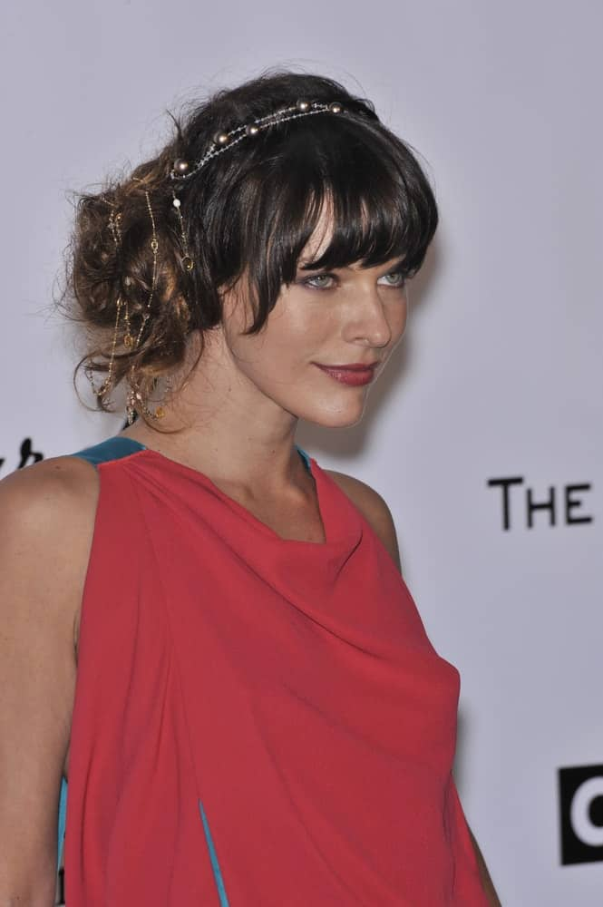 Milla Jovovich was at the 61st Annual Cannes Film Festival amfAR's Cinema Against AIDS 2008 Gala at Le Moulin de Mougins restaurant on May 22, 2008, in Cannes, France. She was stunning her fashionable pink dress and messy bun hairstyle with bangs.