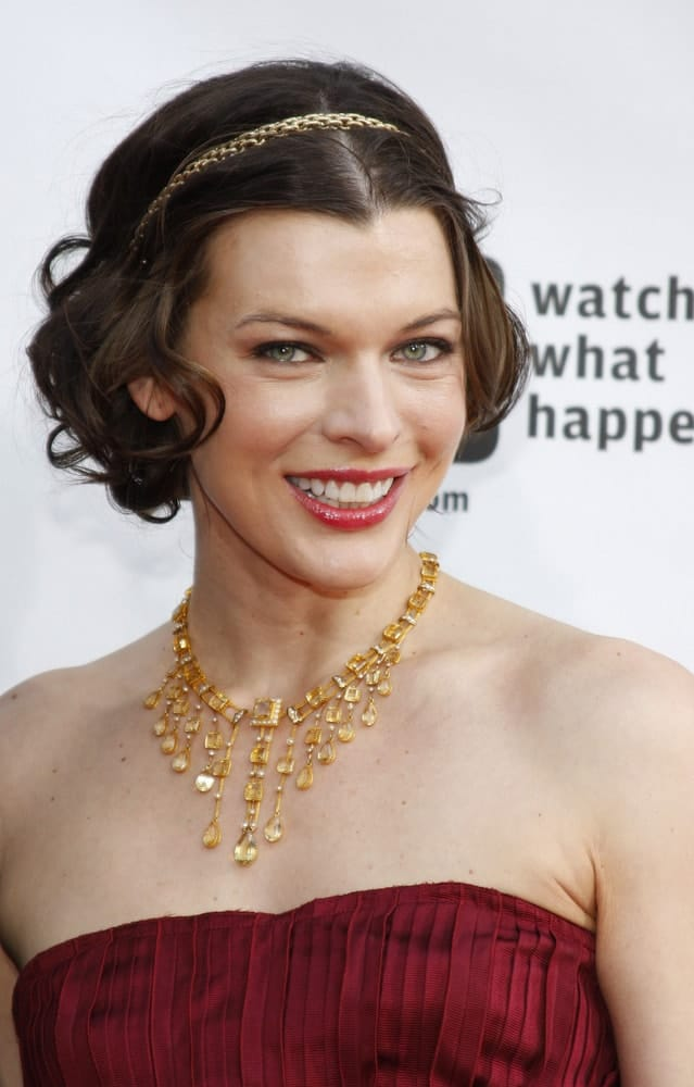 On May 4, 2009, in Los Angele, Milla Jovovich at the Bravo's 2nd Annual A-List Awards held at the Orpheum Theater in Los Angeles, California. She wore a red strapless dress with gold accessories and a gold headband for her tousled and curly chin-length hairstyle.