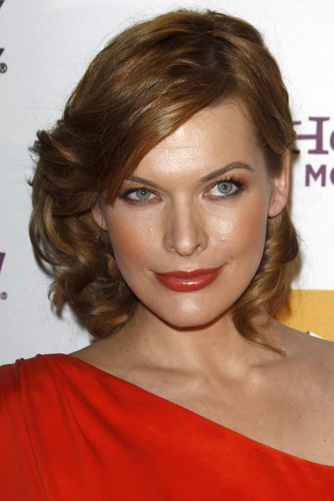 Milla Jovovich was at the 14th Annual Hollywood Awards Gala at Beverly Hilton Hotel on October 25, 2010 in Beverly Hills, CA. She wore a red dress that paired well with her red lips and tousled shoulder-length brunette hairstyle.