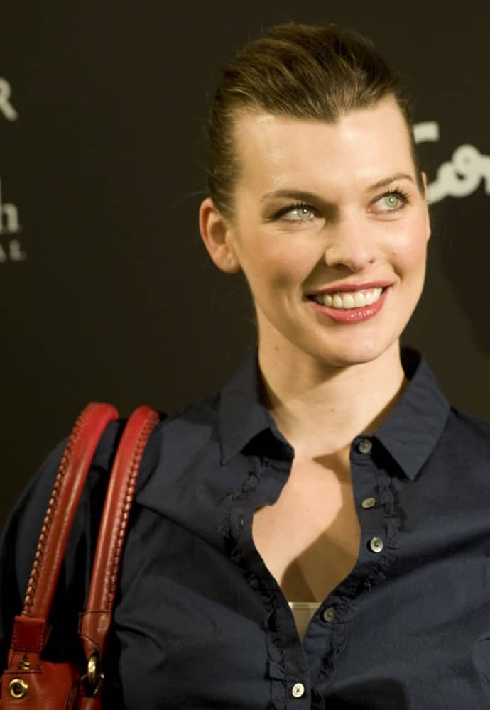 Milla Jovovich was at the presentation of the new Tommy Hilfiger complements collection on March 18, 2010 in Madrid. She was lovely in a dark outfit to pair with her slicked back neat hairstyle and simple makeup.