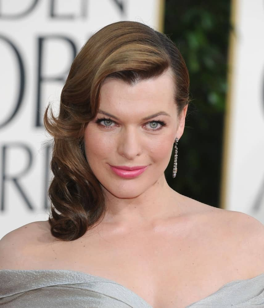 Milla Jovovich attended the 68th Annual Golden Globe Awards on January 16, 2011 in Beverly Hills, CA. She wore a lovely silvery dress that paired perfectly with side-swept wavy and layered brunette hairstyle.