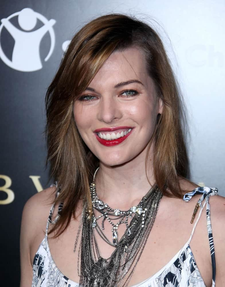 Milla Jovovich was at the Bvlgari Hosts Funraiser for Save The Children on January 13, 2011 in Los Angeles, CA. She paired her black and white dress with a medium-length brunette hairstyle that is layered and tousled.
