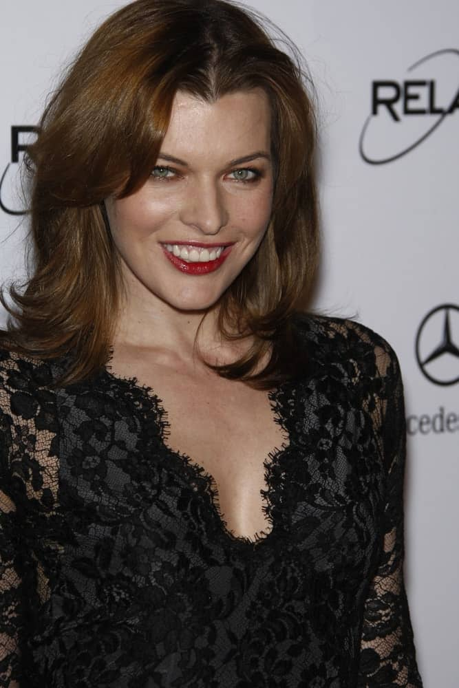 Milla Jovovich attended the Art Of Elysium 'Heaven' Gala 2011 at The California Science Center Exposition Park in Los Angeles, CA on January 15, 2011. She came in a sexy black dress and shoulder-length brunette hairstyle that has long side bangs.