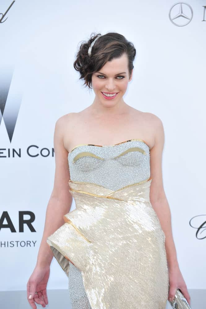 Milla Jovovich was at the 2012 amfAR Cinema Against AIDS Gala at the Hotel du Cap, Antibes on May 24, 2012, in Antibes, France. Her sparkly gold and silver dress paired well with the clip on her side-swept tousled pixie hairstyle.