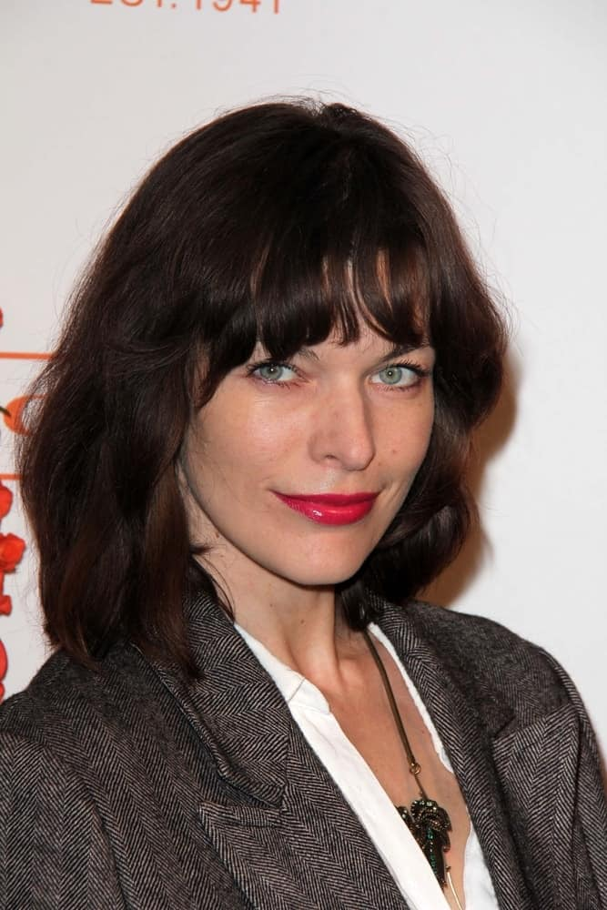 Milla Jovovich was at the Coach's 3rd Annual Evening of Cocktails and Shopping at the Bad Robot on April 10, 2013 in Santa Monica, CA. She went with a simple smart casual outfit to pair with her red lips and loose tousled brunette hairstyle with bangs and layers.