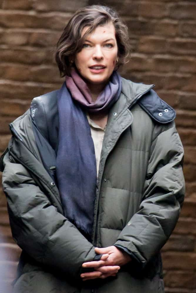 Milla Jovovich was spotted filming her latest movie in London on February 15, 2013 in London, UK. She was wearing a winter jacket with a scarf and her highlighted chin-length hair was side-swept and tousled.