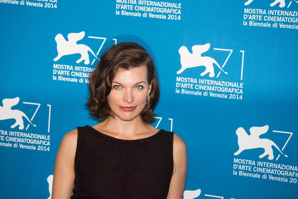 Milla Jovovich attended the 'Cymbeline' Photocall during the 71st Venice Film Festival on September 3, 2014 in Venice, Italy. She was lovely in her dark dress and side-swept wavy chin-length brunette hairstyle.