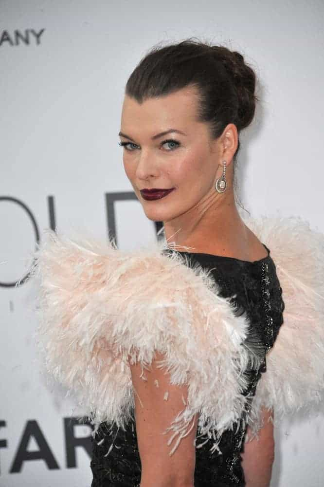 On May 22, 2014, Milla Jovovich was at the 21st annual amfAR Cinema Against AIDS Gala at the Hotel du Cap d'Antibes. She was stunning in her ruffled dress, dark lips, and slicked back raven bun hairstyle.