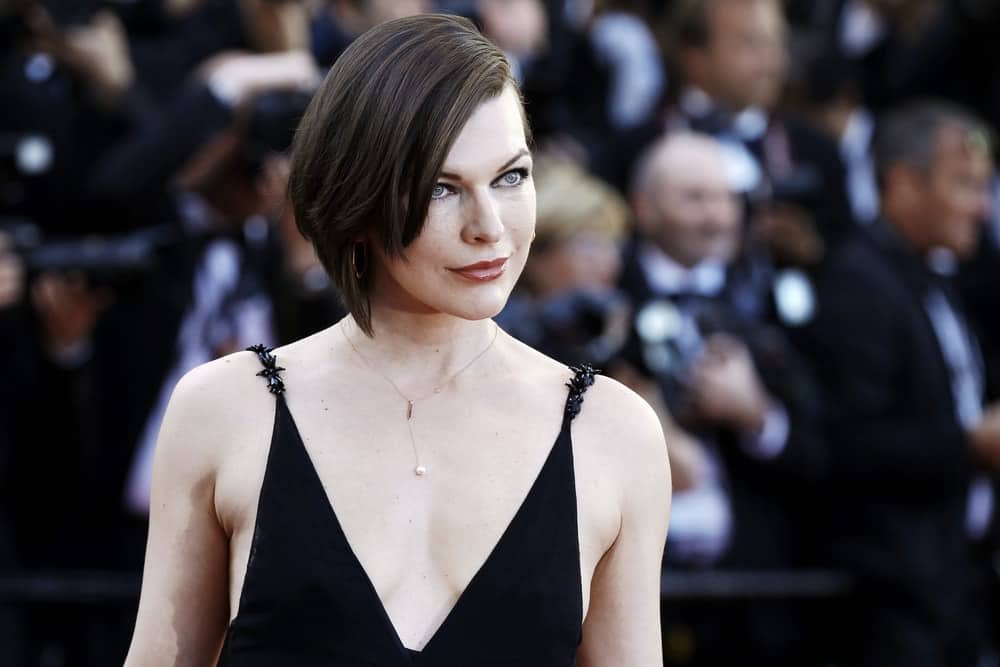 On MAY 20, 2020, Milla Jovovich attended the 'The Last Face' Premiere during the 69th Cannes Film Festival on May 20, 2016 in Cannes, France. She was stunning in a black dress and a chin-length raven hairstyle with long side-swept bangs.