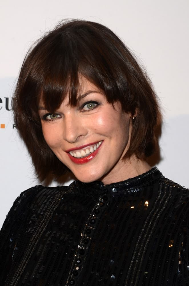 Milla Jovovich was at the What Goes Around Comes Around Boutique Grand Opening on October 13, 2016 in Beverly Hills, CA. She wore an elegant sparkly black dress that matched well with her short raven hairstyle with subtle highlights and bangs.