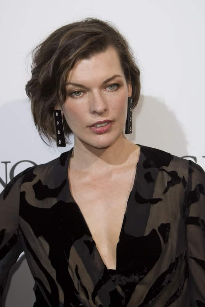 Milla Jovovich attended the De Grisogono Party at the annual 69th Cannes Film Festival at Hotel du Cap-Eden-Roc on May 17, 2016 in Cap d'Antibes, France. She wore a black patterned dress with her tousled chin-length hairstyle that has side-swept bangs.