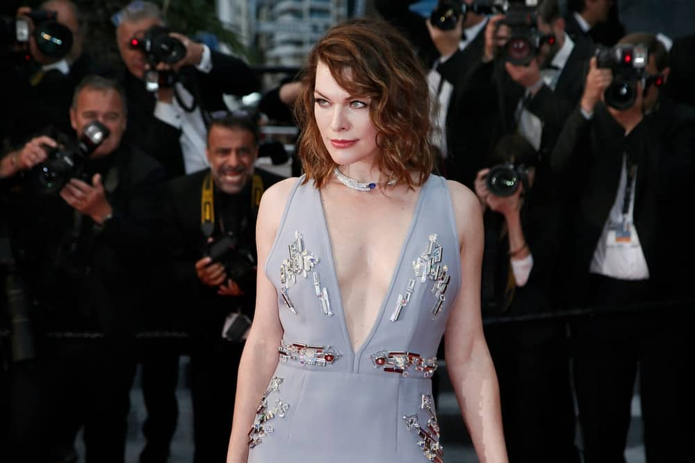 Milla Jovovich attended the screening of 'Burning' during the 71st Cannes Film Festival on May 16, 2018 in Cannes, France. She wore a stunning gray dress that she paired with her brunette tousled hairstyle that has waves and layers.