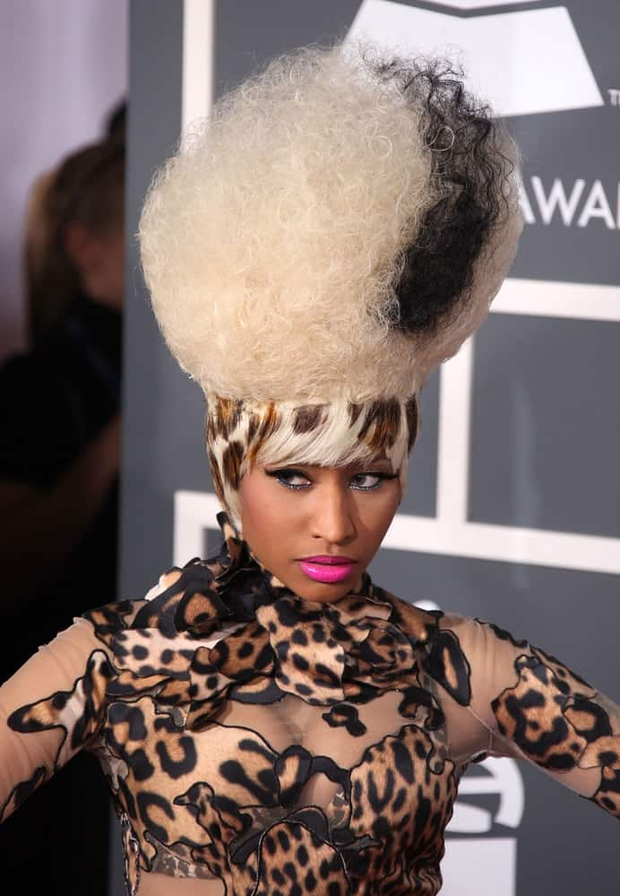 Nicki Minaj was at the 2011 Grammy Awards on February 13, 2011 in Los Angeles, CA. She wore an animal print sheer body suit to pair with her unique Frankenstein's bride beehive blond hairstyle dyed with black and animal print at the base.