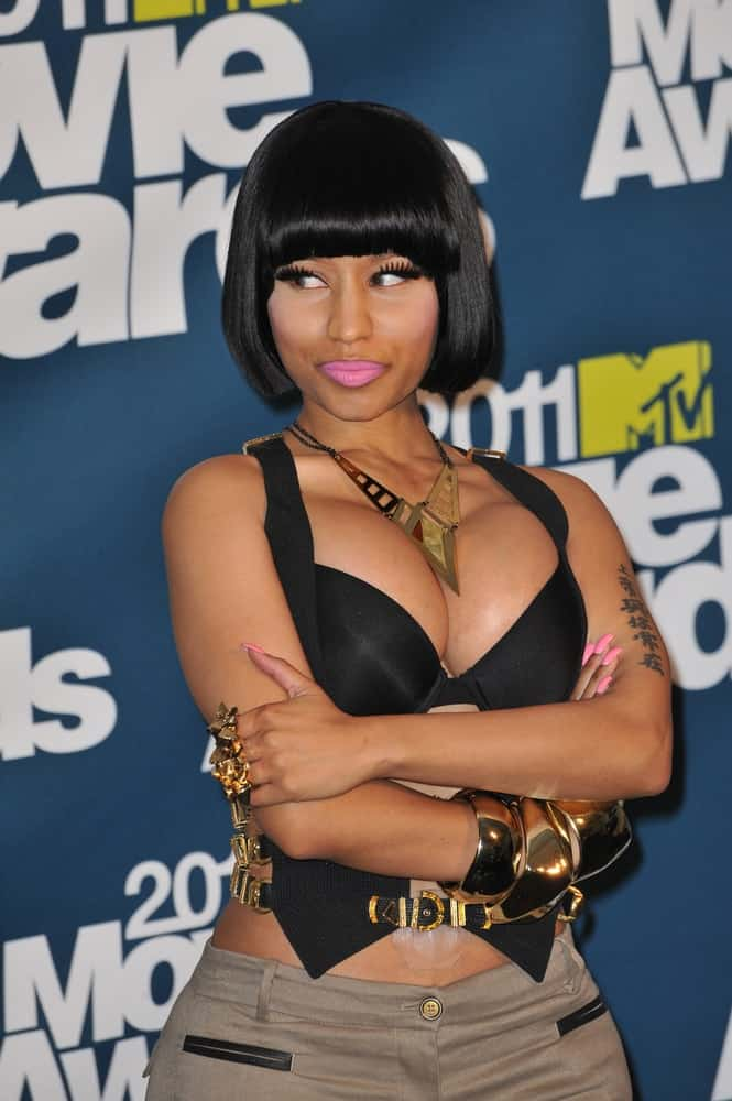 Nicki Minaj was at the 2011 MTV Movie Awards at the Gibson Amphitheatre, Universal Studios, Hollywood on June 5, 2011 in Los Angeles, CA. She went with a casual outfit to pair with her chin-length raven straight hairstyle with blunt bangs.