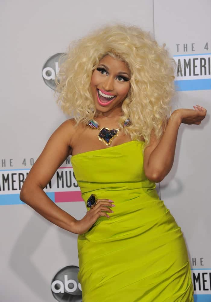 Nicki Minaj was at the 40th Anniversary American Music Awards at the Nokia Theatre LA Live on November 18, 2012 in Los Angeles, CA. She wore a neon green dress that she paired with a blond tousled and curly thick hairstyle.