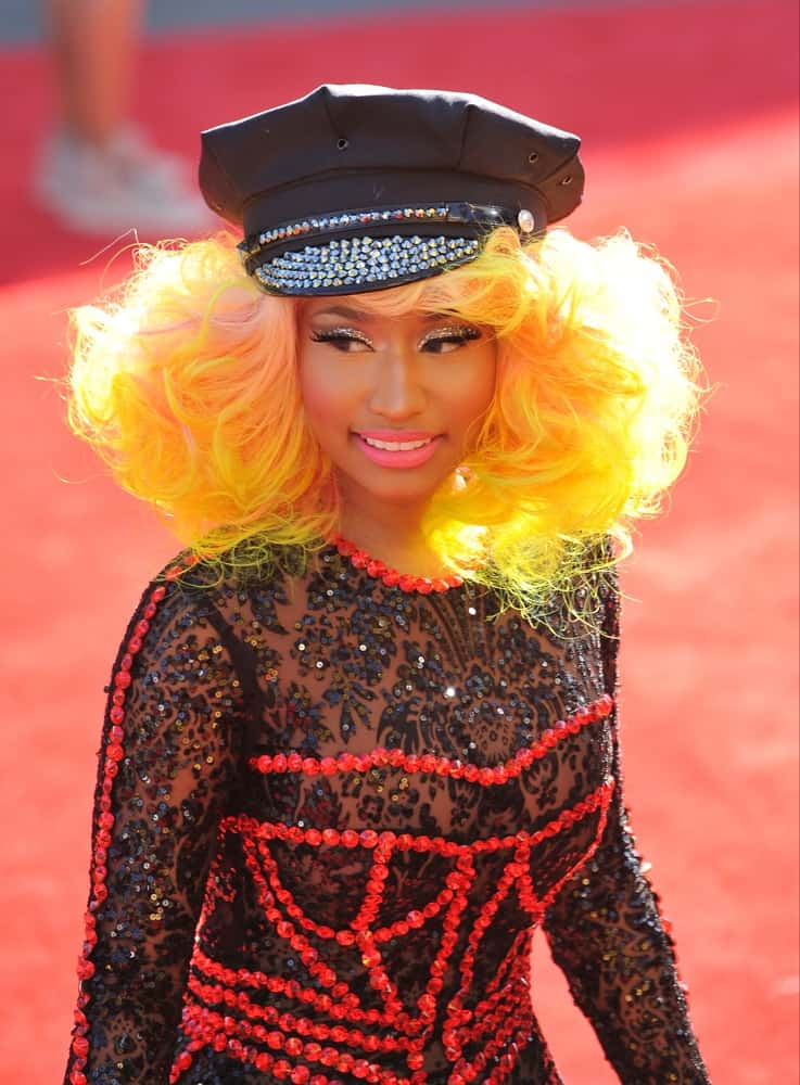 On September 6, 2012, Nicky Minaj was at the 2012 MTV Video Music Awards at Staples Center, Los Angeles. She wore an artistic red and black body suit that she paired with a tousled and curly yellow-dyed shoulder-length hairstyle.