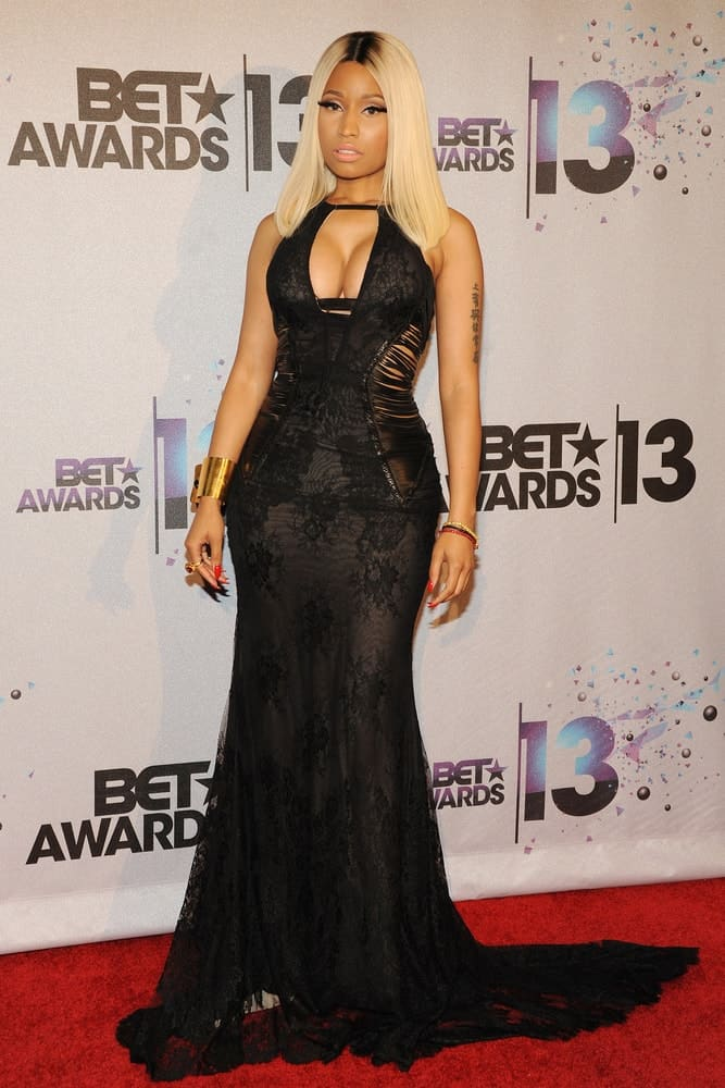 Nicki Minaj paired her lovely black long dress with a straight and loose medium-length blond hairstyle that curtains her face quite well at the 2013 BET Awards at Nokia Theater L.A. Live on June 30, 2013 in Los Angeles, California.