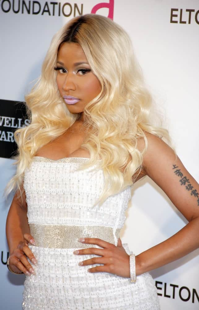Nicki Minaj paired her brilliant white sequined dress with an equally bright loose and tousled blond hairstyle with layers and curls at the 21st Annual Elton John AIDS Foundation Academy Awards Viewing Party held at the Pacific Design Center in West Hollywood on February 24, 2013.