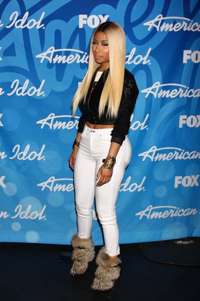 Nicki Minaj was in attendance at the American Idol Season 12 Finale Press Room at the Nokia Theater at LA Live on May 16, 2013. She was seen wearing a casual ensemble outfit with a black jacket that emphasized her long and straight blond hairstyle loose on her shoulders.