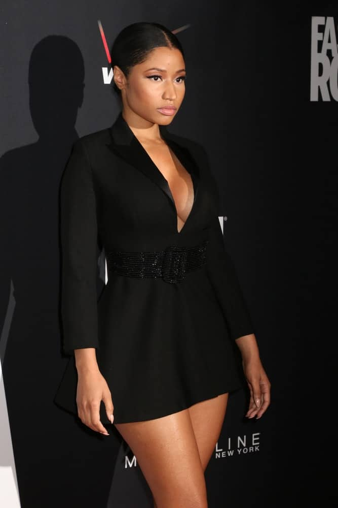 Nicki Minaj was quite beautiful in her short black dress that went quite perfectly with her neat and slick bun hairstyle when she attended the Fashion Rocks at the Barclays Center on September 9, 2014 in New York.
