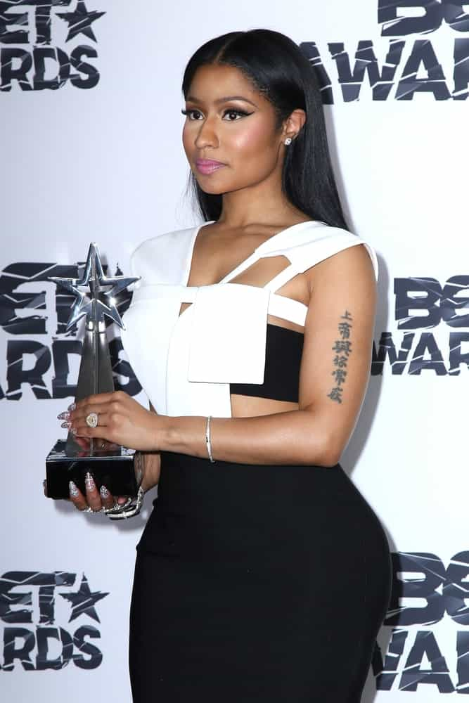 Nicki Minaj went with a simple yet lovely look to her black and white dress that went quite well with her straight raven long hairstyle tucked behind her ears at the 2015 BET Awards - Press Room at the Microsoft Theater on June 28, 2015 in Los Angeles, CA.