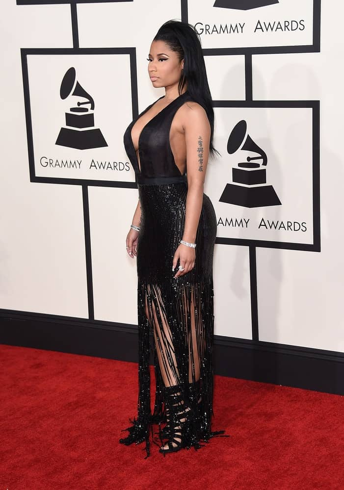 Nicki Minaj was in attendance at the Grammy Awards 2015 on February 8, 2015 in Los Angeles, CA. She came wearing an elegant and shiny black dress that she paired with a tousled and side-swept raven hairstyle.