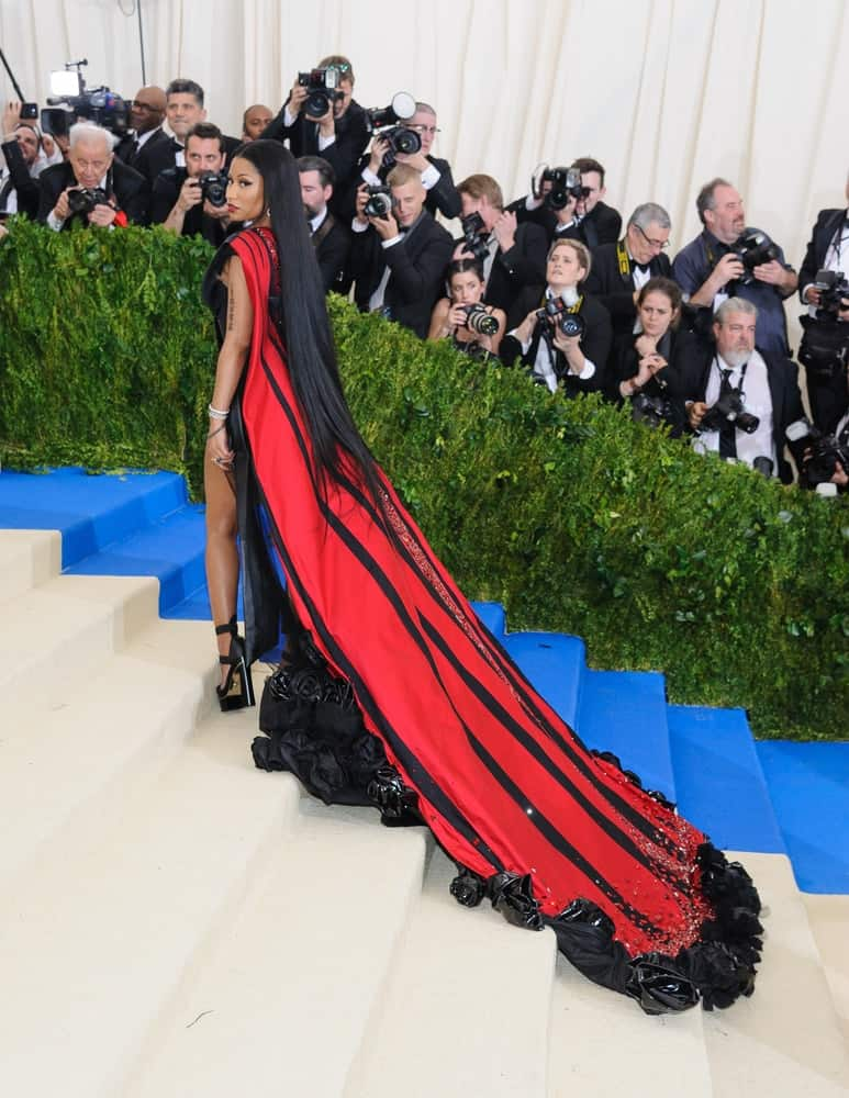 Nicki Minaj attended the 2017 Metropolitan Museum of Art Costume Institute Benefit Gala at The Metropolitan Museum of Art in New York, NY on May 1, 2017. She was seen wearing a long red gown that she paired with her very long and straight raven hair on her back.