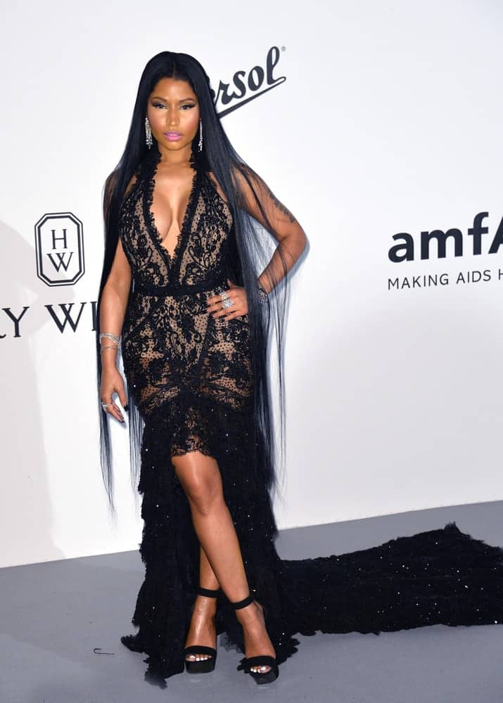 On May 25, 2017, Nicky Minaj flaunted her very long and straight raven loose hairstyle with a black dress at the 24th amfAR Gala Cannes at the Hotel du Cap-Eden-Roc, Antibes.