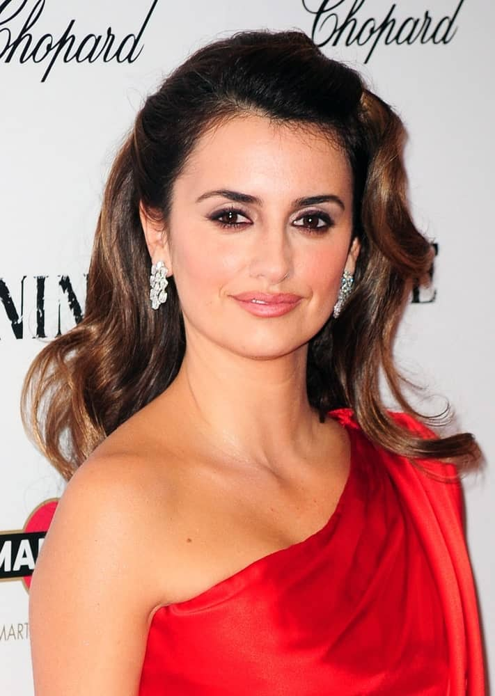 Penelope Cruz looks ravishing in a red halter dress paired with her glamorous waves that are pinned to emphasize her features. This look was worn at New York Premiere of Nine on December 15, 2009.