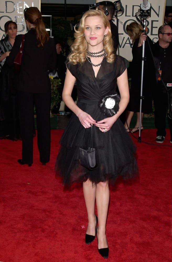 Young Actress Reese Witherspoon wore a lovely black dress with her medium-length blond hairstyle that has layers and curls at the tips for a vintage look at the 2001 Golden Globe Awards at the Beverly Hilton Hotel on January 21, 2001.