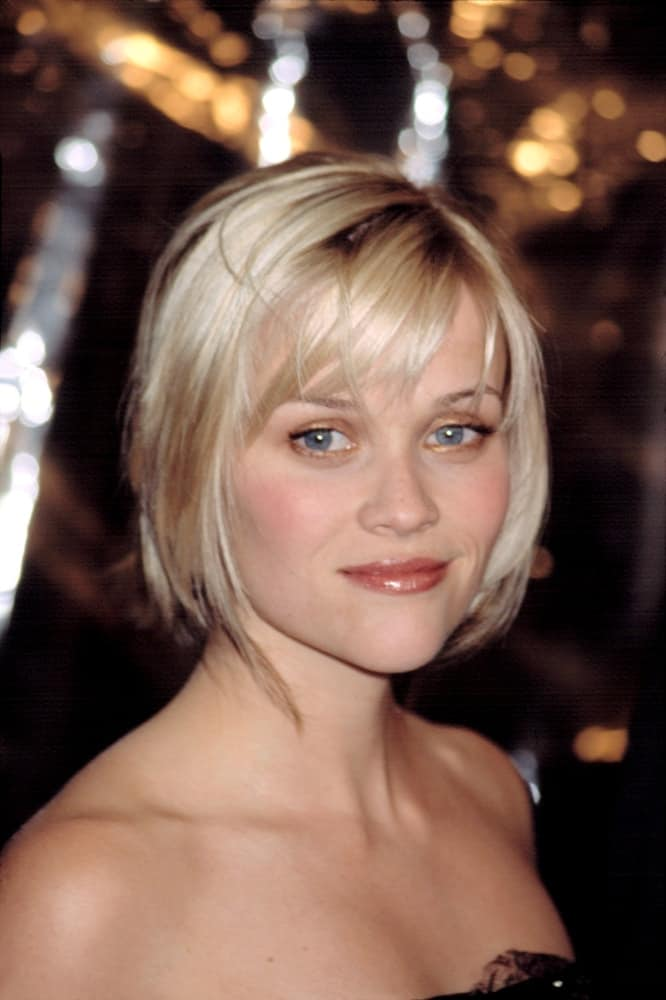 Reese Witherspoon wore a black strapless dress with her layered chin-length hairstyle with bangs and highlights at the premiere of THE IMPORTANCE OF BEING EARNEST in New York on May 13, 2002.