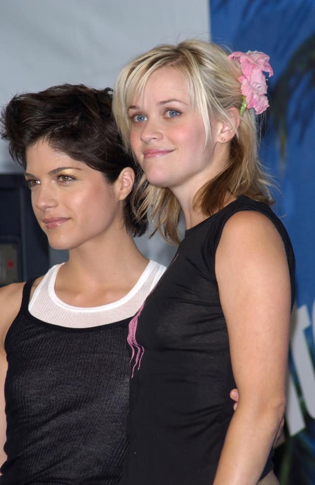 Actresses Selma Blair and Reese Witherspoon were at the 2002 Teen Choice Awards at Universal Studios, Hollywood on August 4, 2002. Witherspoon came wearing a casual outfit to match with her cute twin ponytails with floral complement and highlights.