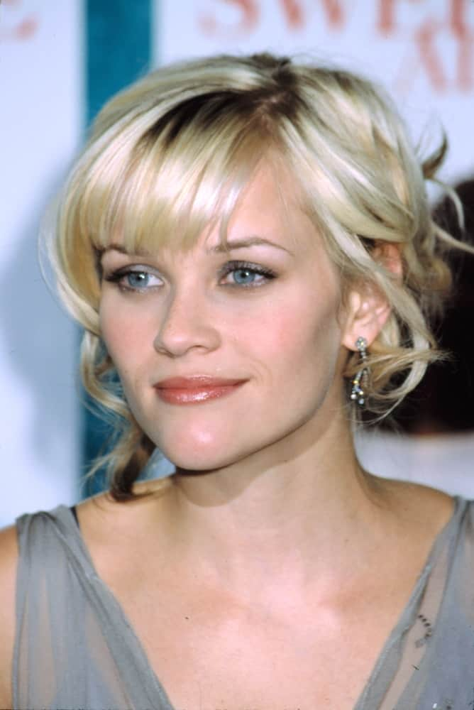 Reese Witherspoon wore a lovely gray sheer dress with her messy and highlighted bun hairstyle that has loose tendrils and bangs at the premiere of SWEET HOME ALABAMA in New York on September 23, 2002.