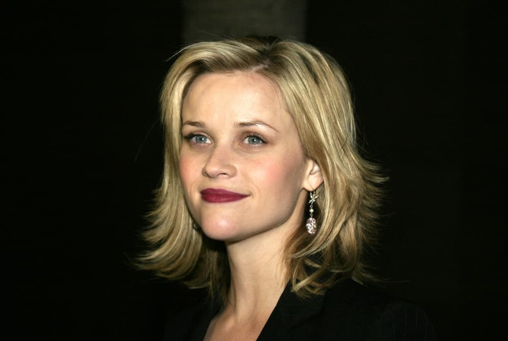 Reese Witherspoon was at the American Cinematheque held at the Egyptian Lloyd E. Rigler Theatre in Hollywood, USA on December 3, 2004. She wore a black outfit with her red lips and tousled blond layered shoulder-length hairstyle.