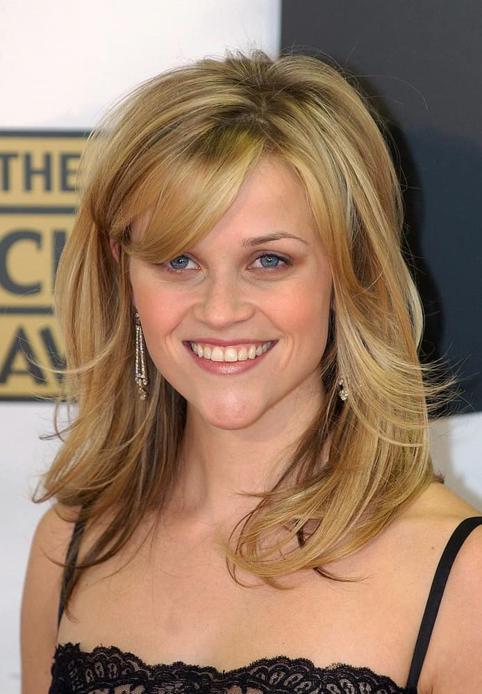 Reese Witherspoon's charming black lace dress paired quite well with her shoulder-length highlighted blond layers with bangs at The 11th Annual Broadcast Film Critics Choice Awards in Santa Monica Civic Auditorium, Santa Monica, CA on January 09, 2006.