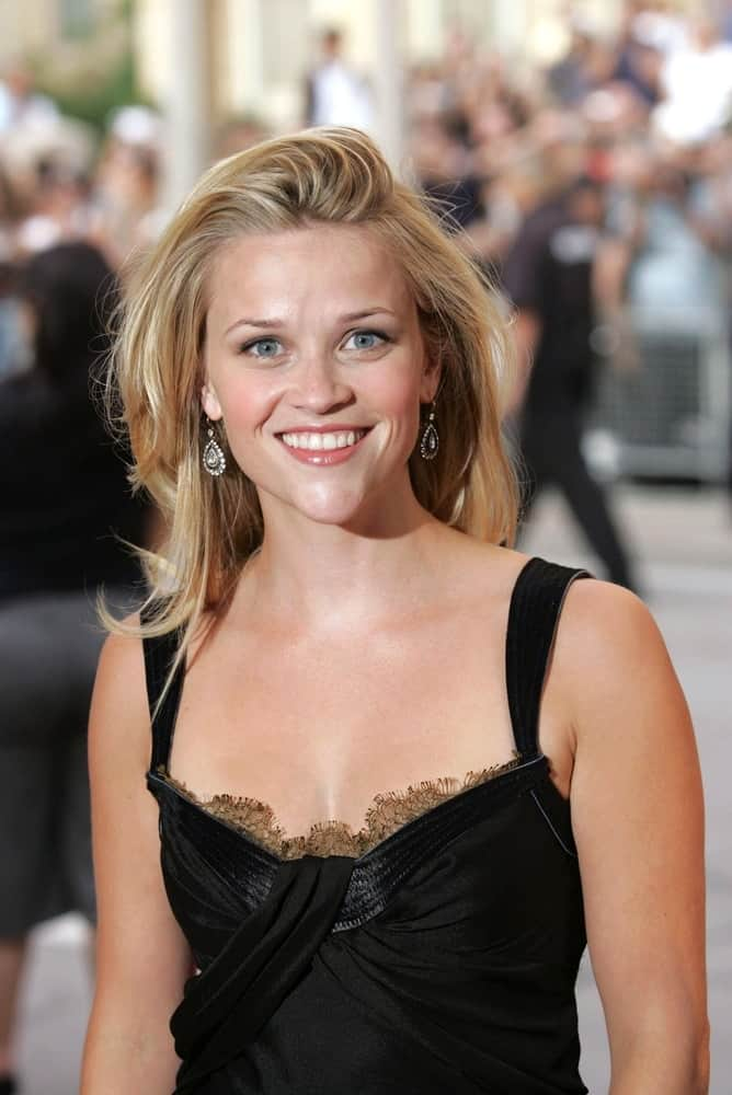 Reese Witherspoon attended the PENELOPE Gala Premiere at the Toronto International Film Festival in Roy Thomson Hall, Toronto, Canada on September 08, 2006. She flashed her beautiful smile complemented by her tousled and side-swept layered blond hairstyle.