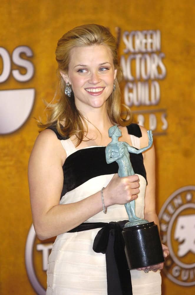 Reese Witherspoon looked quite lovely in her Yves Saint Laurent dress at the 12th Annual Screen Actors Guild SAG Awards in The Shrine Auditorium, Los Angeles on January 29, 2006. She paired this with a half-up blond hairstyle with highlights and a slight tousle.