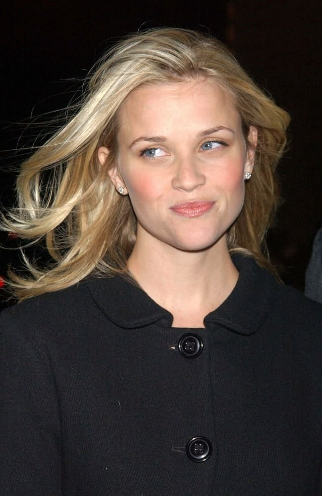 Reese Witherspoon's wind-swept tousled sandy blond hairstyle had layers and side-swept bangs at the Cinema Society Screening of Flags of Our Fathers held at the Tribeca Grand Hotel Screening Room in New York, NY on October 16, 2006.