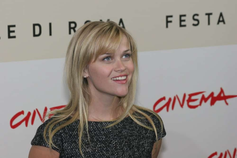 Actress Reese Witherspoon went with a simple look to her gray dress and loose, tousled and highlighted blond hairstyle with layers and bangs at the photocall for the movie 'Rendition' during day 4 of the 2nd Rome Film Festival on October 21, 2007 in Rome, Italy.