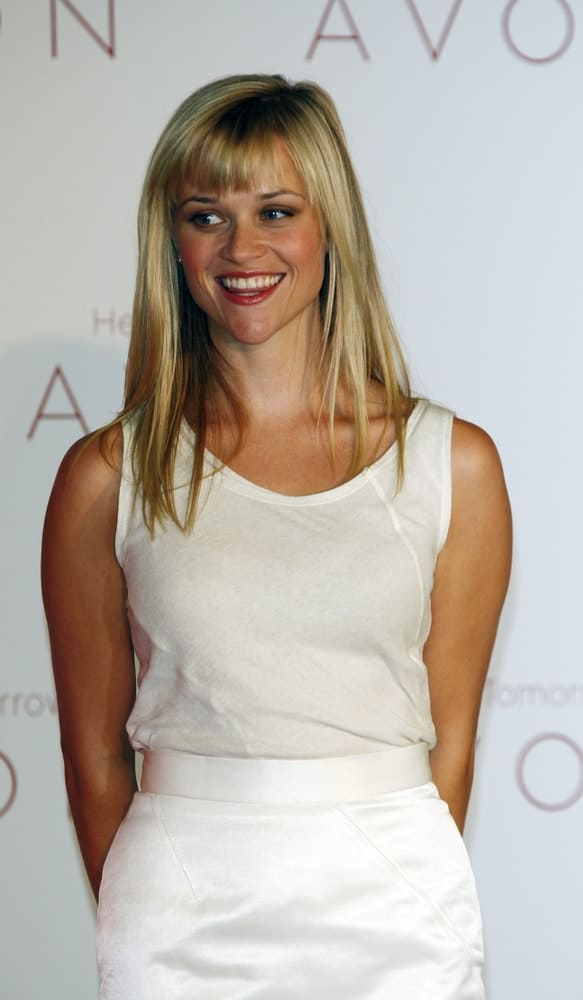 Reese Witherspoon was awarded as Avon Global Ambassador at a news conference in Beverly Hills, CA on August 1, 2007. She was quite charming in her all-white outfit that she paired with her straight blond hairstyle with bangs.